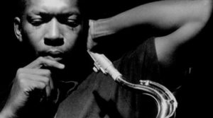 John Coltrane with Tenor wetting a reed