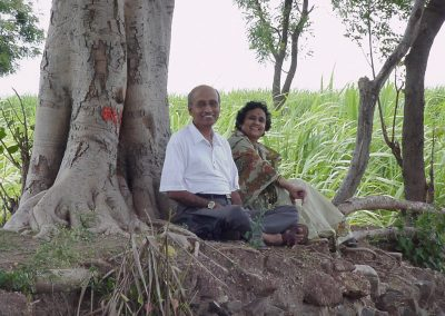 Dr. Vasant Lad and Usha under their Banyan Tree at farm