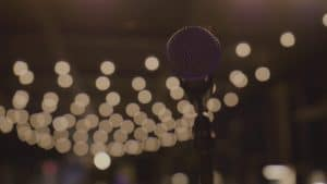 videoblocks-microphone-on-a-stand-low-angle-with-string-lights-in-the-background-cozy-warm-and-inviting-bar-with-stage-4k-ultra-hd-169_sbjllan9z_thumbnail-full01.jpg