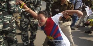 Tibetan Arrested for wearing a T-Shirt with Tibetan flag