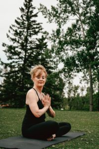 Women in Meditation prayer pose by Keren Perez from Unsplash