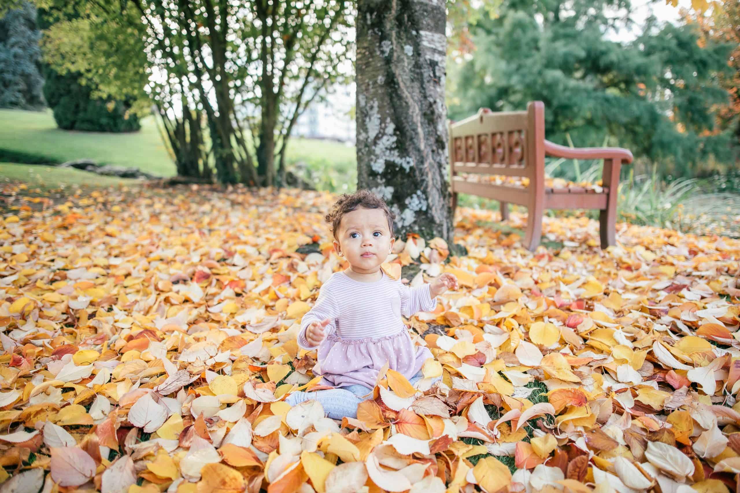 humphrey-muleba-child in leaf pile-unsplash