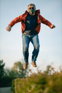 Man Jumping with Mask on by adam-niescioruk