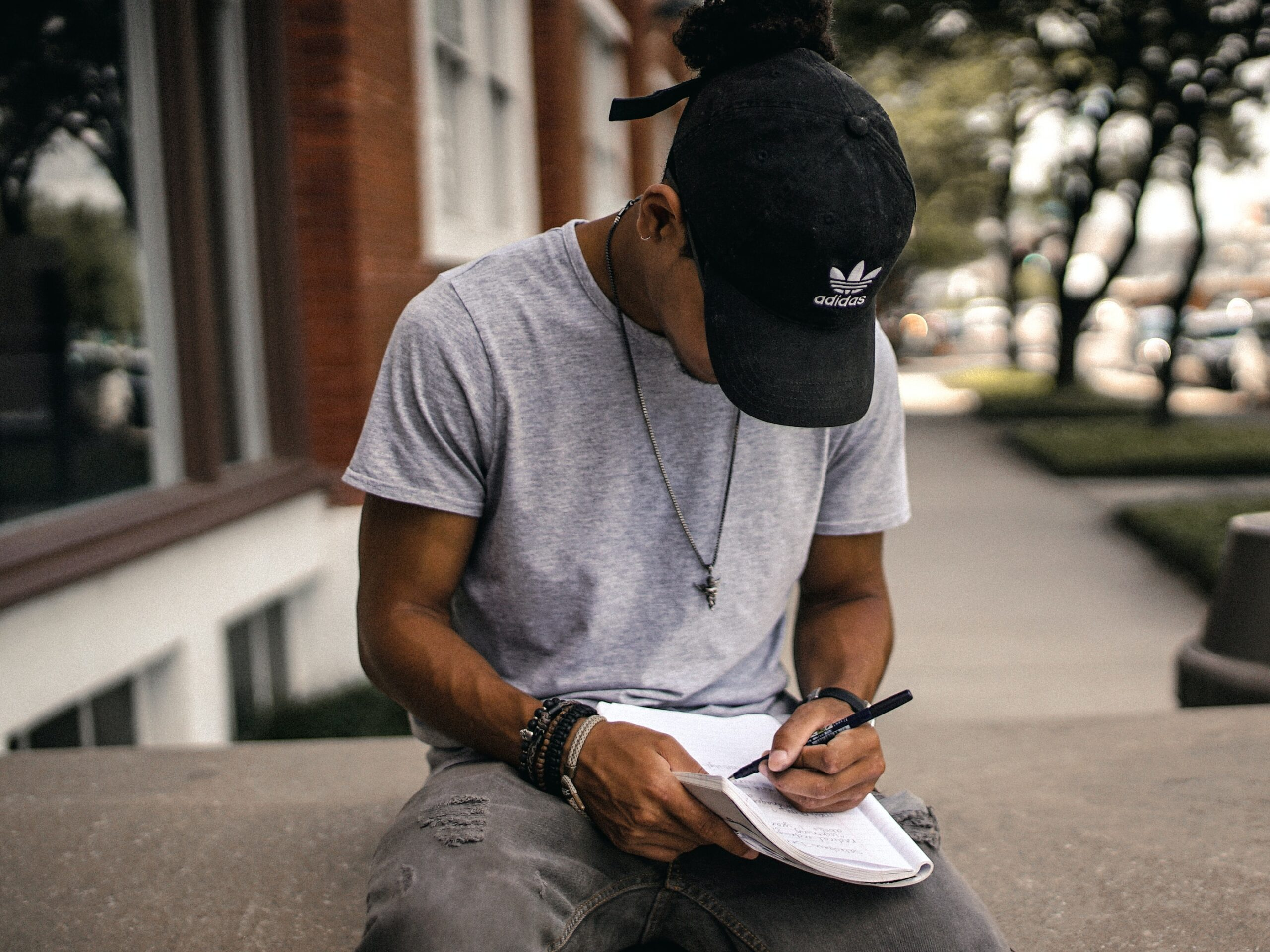 brad-neathery-Student taking notes-unsplash