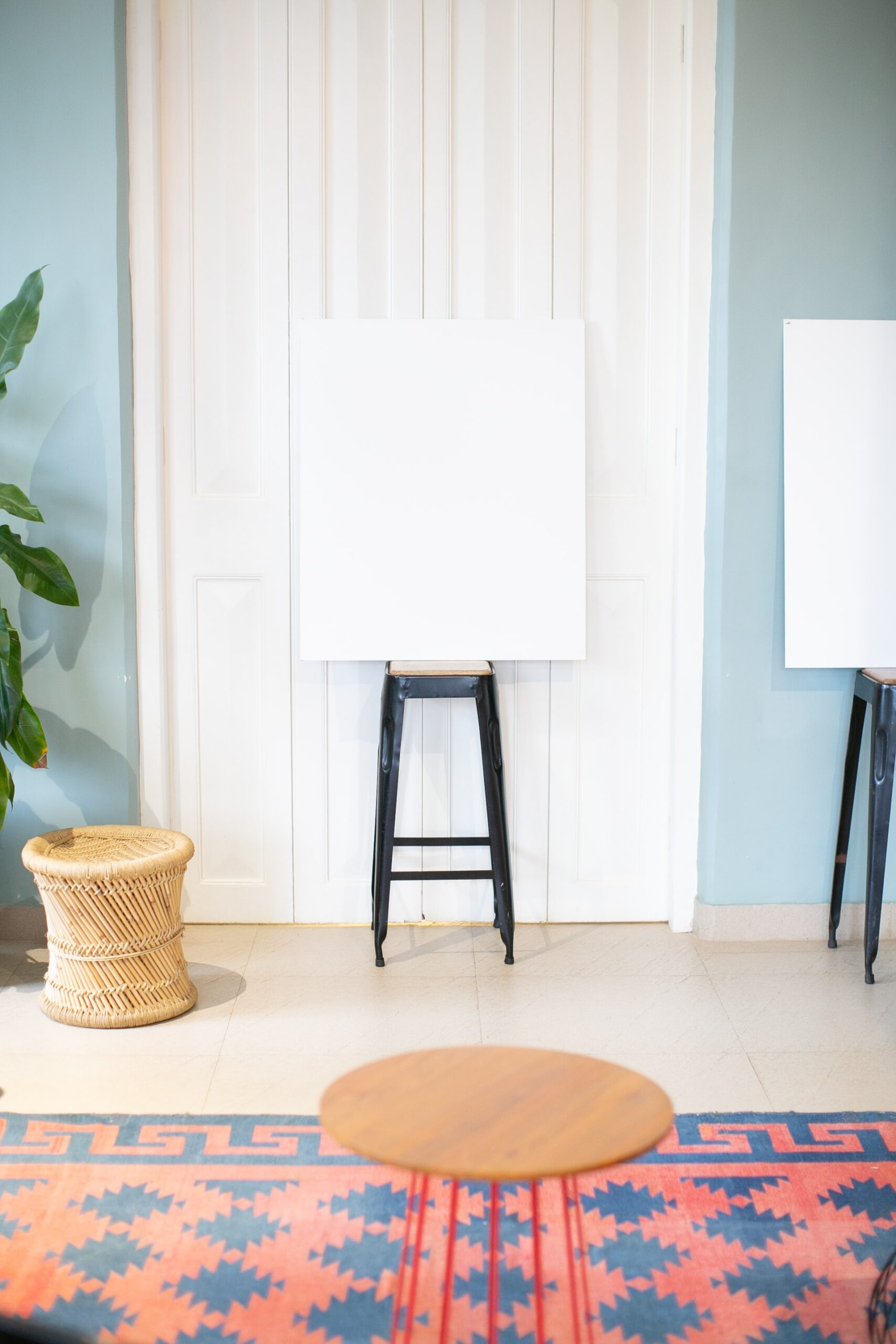 raj-rana-clean whiteboard on a stool in front of a white door-unsplash