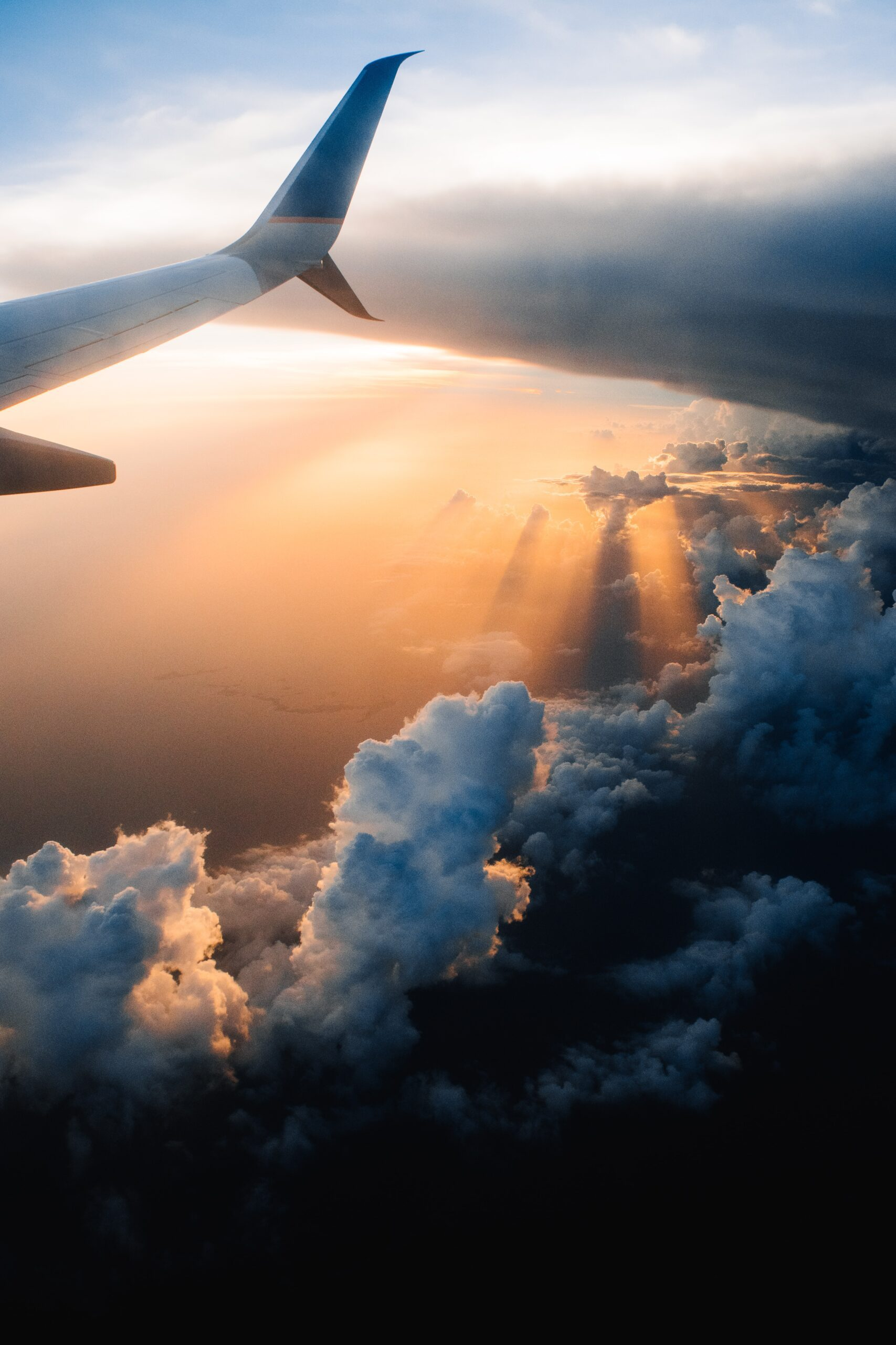 tom-barrett-tail of jet, clouds and water below-unsplash