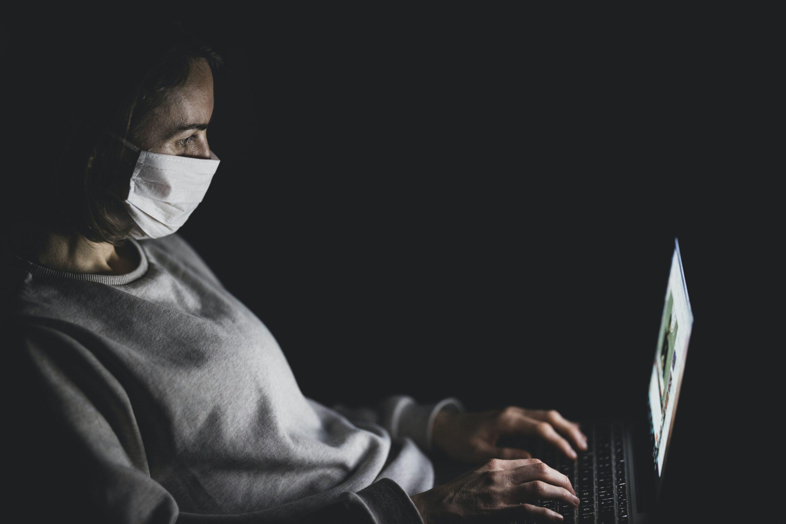 engin-akyurt-Student with mask studying on laptop-unsplash