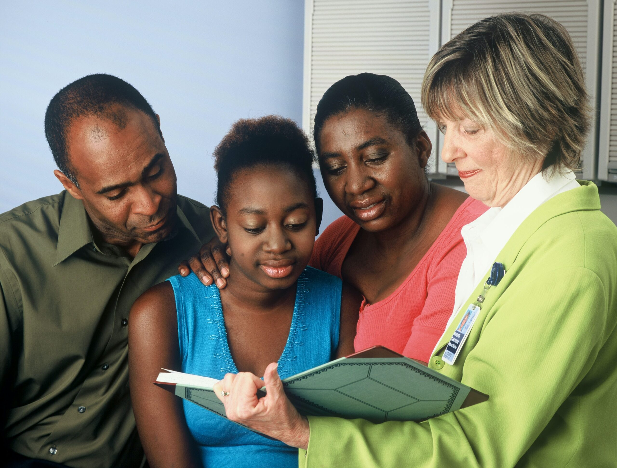 Family reviewing test results together with physician Photo by National Cancer Institute on Unspl