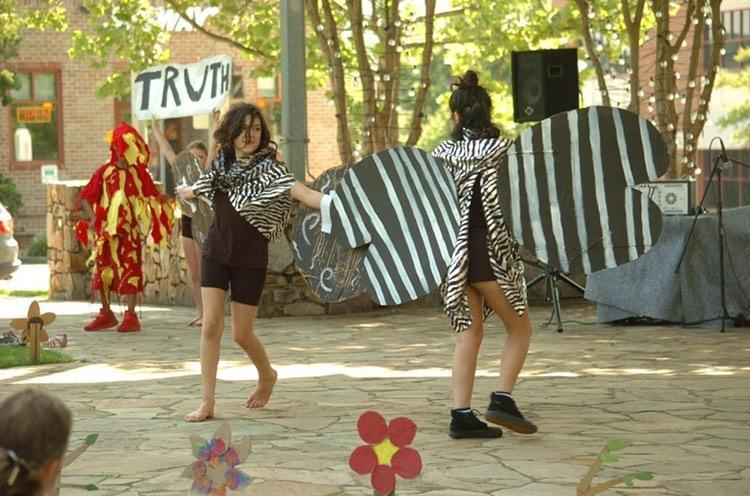 123 Puppetry performance at Southern Village, Spring 2019-see the light. Featured Puppeteers actors Zola Ramirez and Fernanda Topete wearing moth wings for the Spring 2019 See the Light while puppeteers in fire costumes dance on each side of the stage