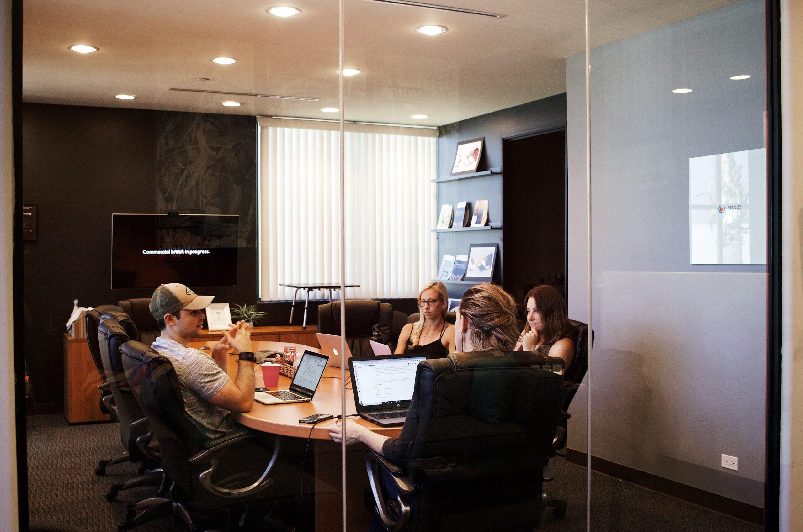 campaign-creators-Students around Board room table -Unsplash