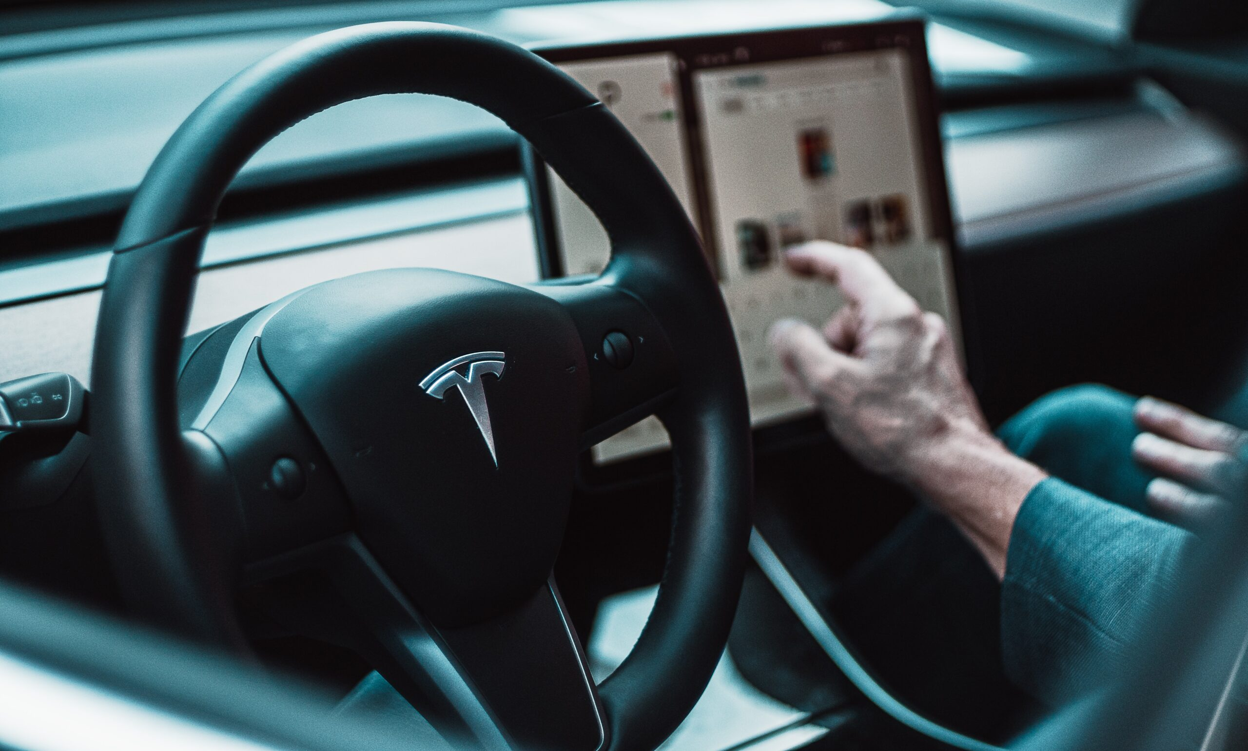 david-von-diemar-Tesla interior Model 3 black steering wheel and Tesla control display-unsplash