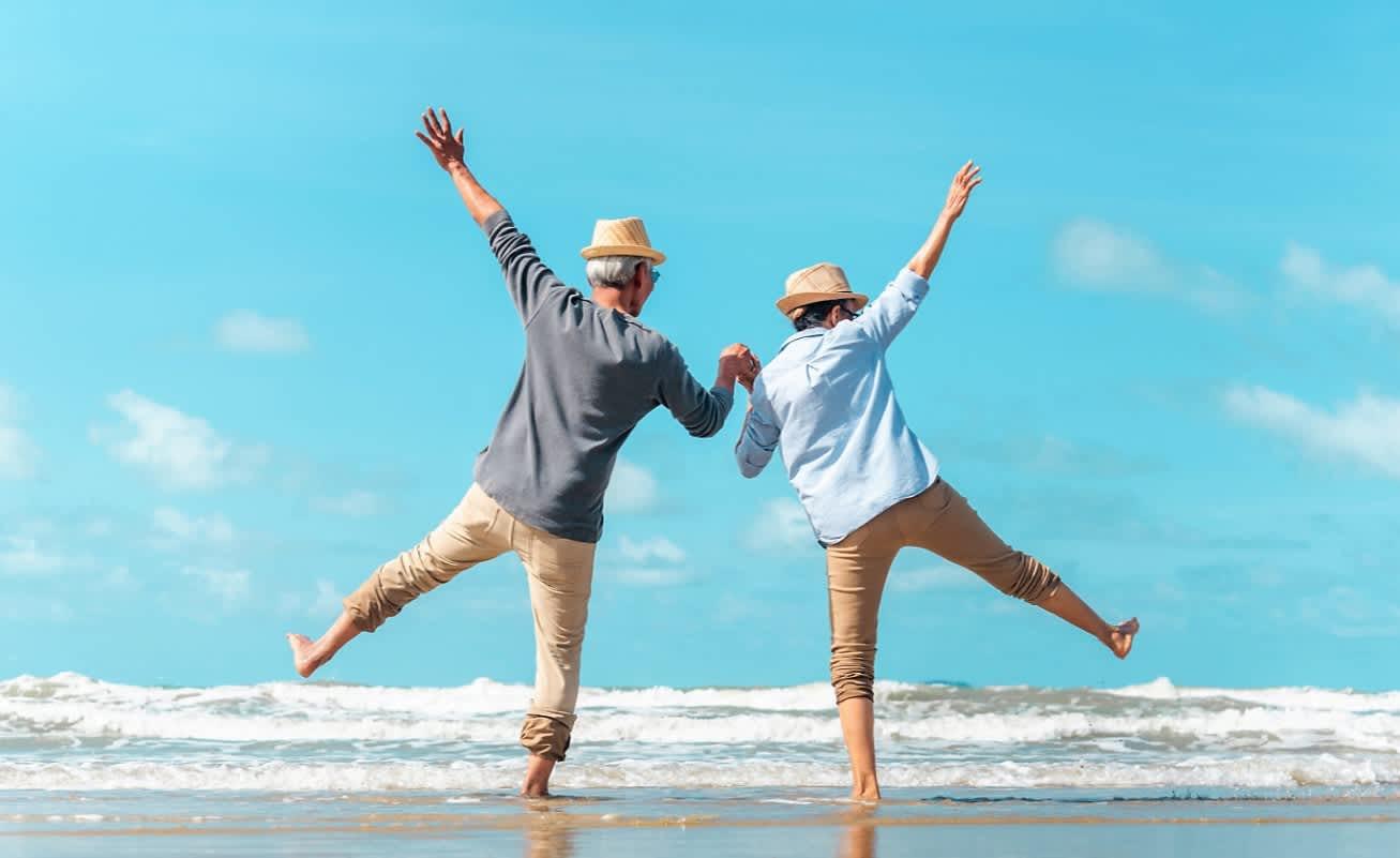 Elderly Couple Enjoying Beach