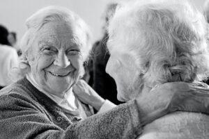 artyom-kabajev-Two friends embracing while smiling with joy-unsplash