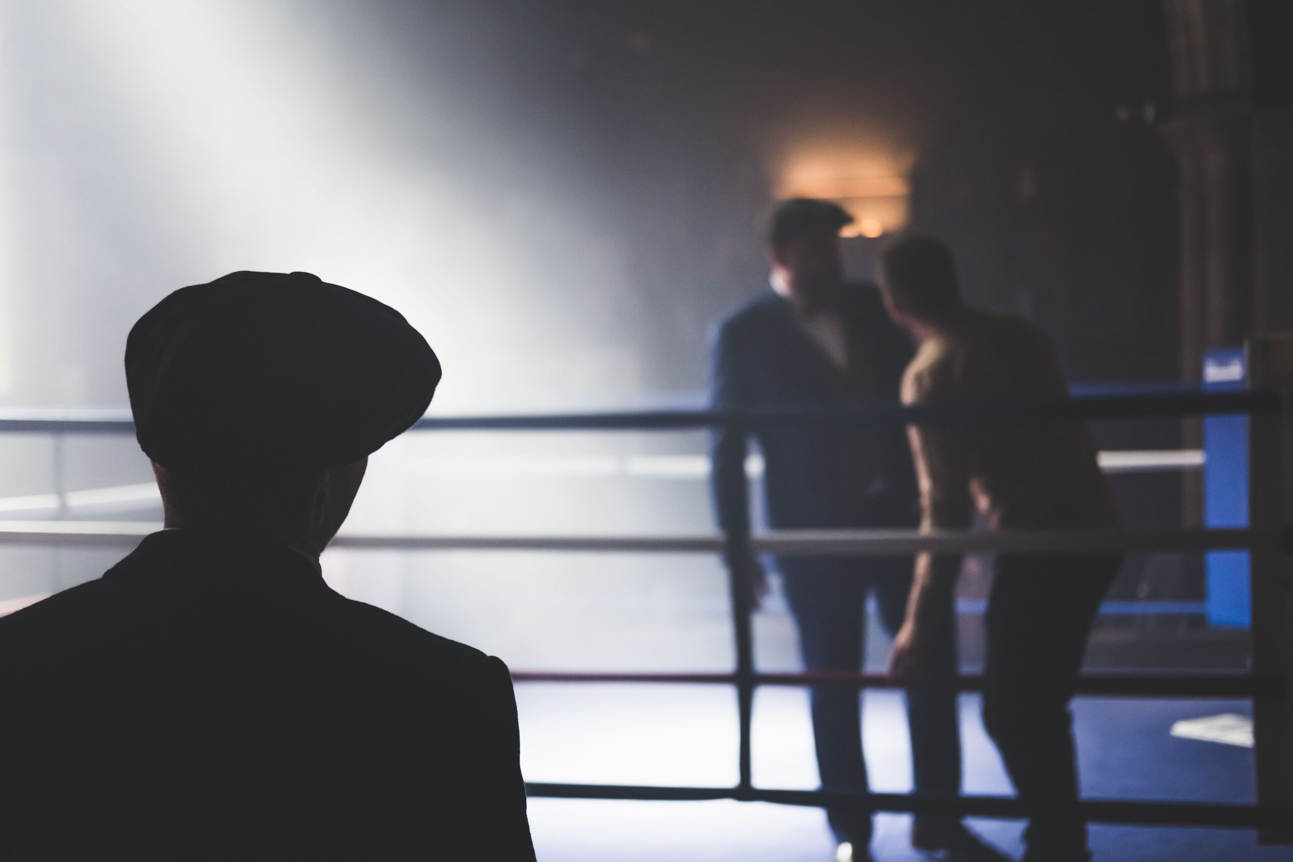 A scene in a boxing ring two men film noir Dan Burton image from Unsplash