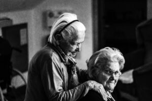 eberhard-grossgasteiger-A massage administered by one senior friend to another-unsplash