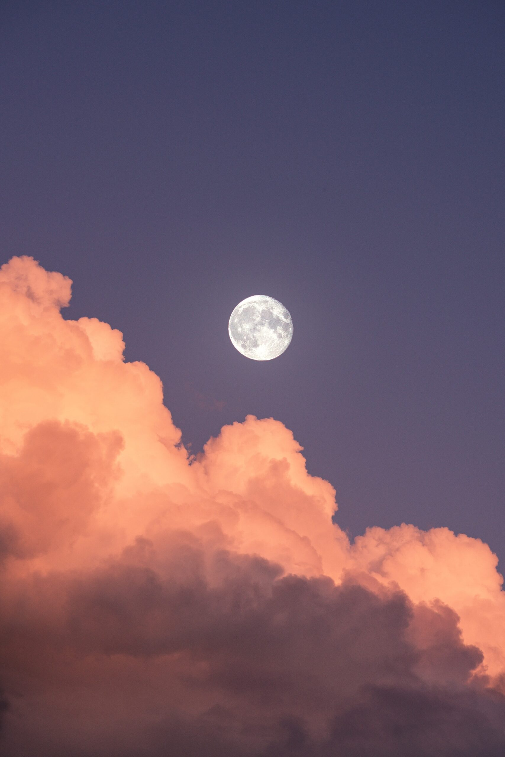 Moon above the clouds by Ingmar from Unsplash