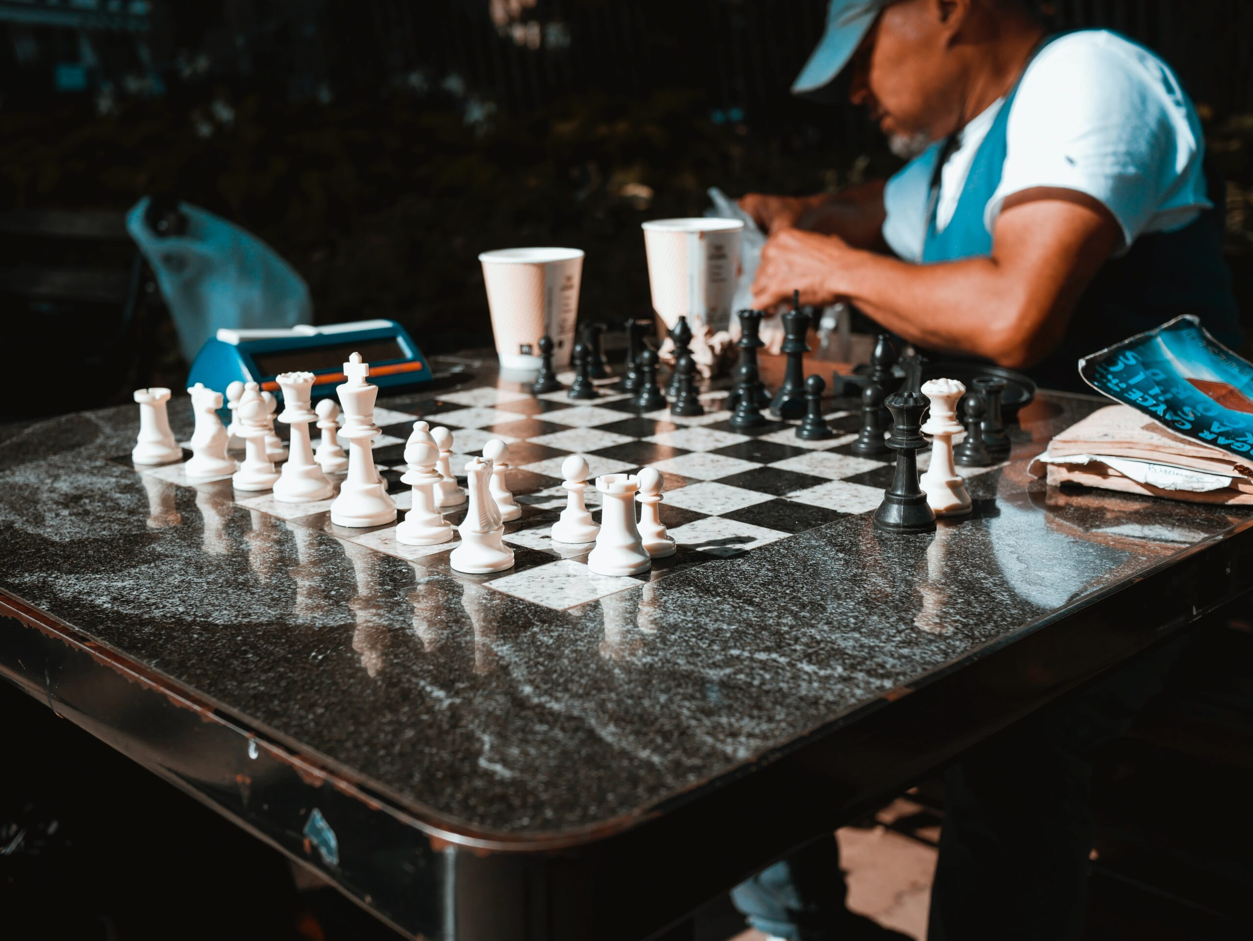 josh-appel-Man at marble chess table set and ready for match partner-unsplash