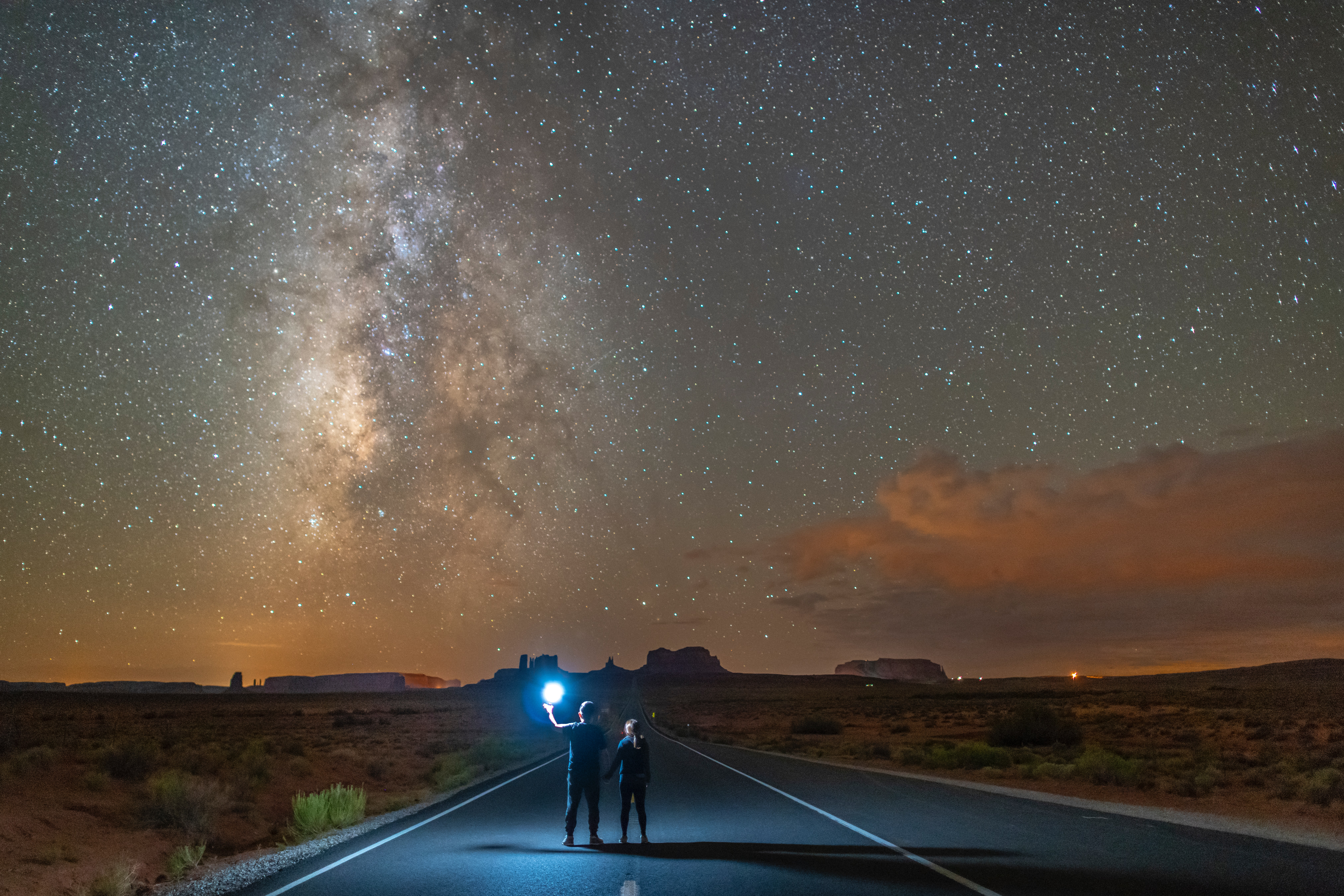 ken-cheung-two children on two lane road from back to night sky full of stars SW-unsplash