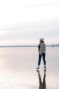 maks-styazhkin-Skater on frozen River-unsplash