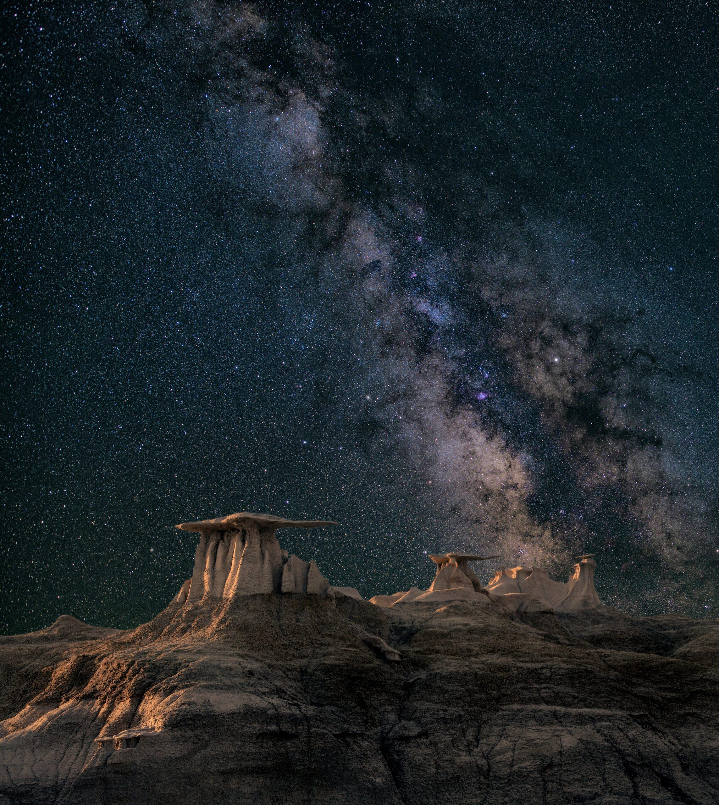 john-fowler-Aurora australis' starry sky over desert landscape-unsplash
