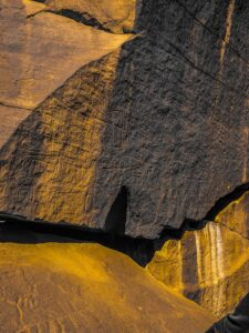 m-k-_side of Rock face with petroglyph carvings-unsplash