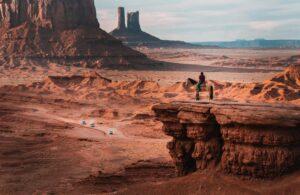 nik-shuliahin-Man on horseback canyon precipice Overlooking desert road below-unsplash