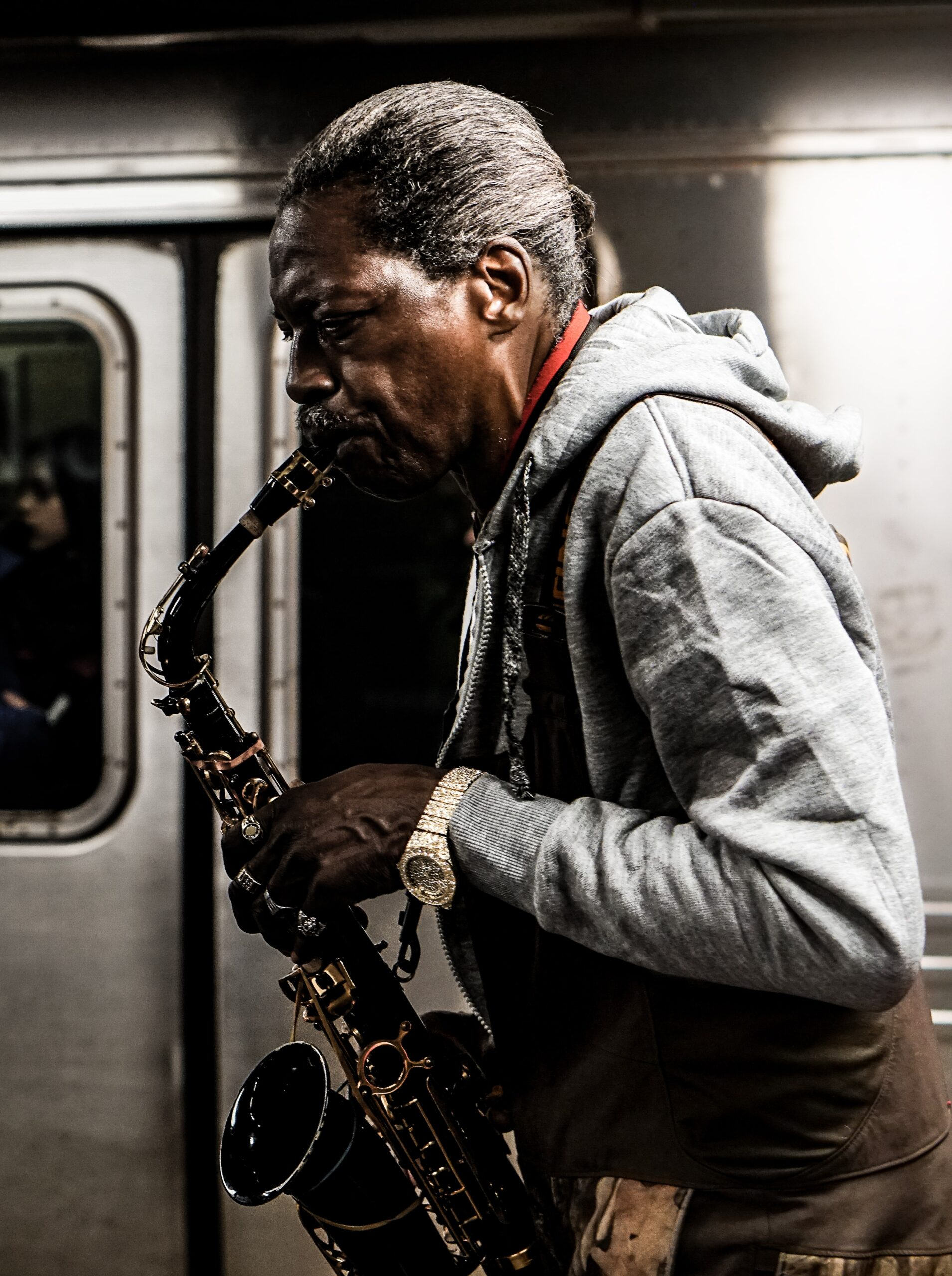 sash-margrie-hunt-Man with black Tenor Sax playing in NYC subway-unsplash