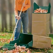 Leaf Chute in action homeowner with rake and chute