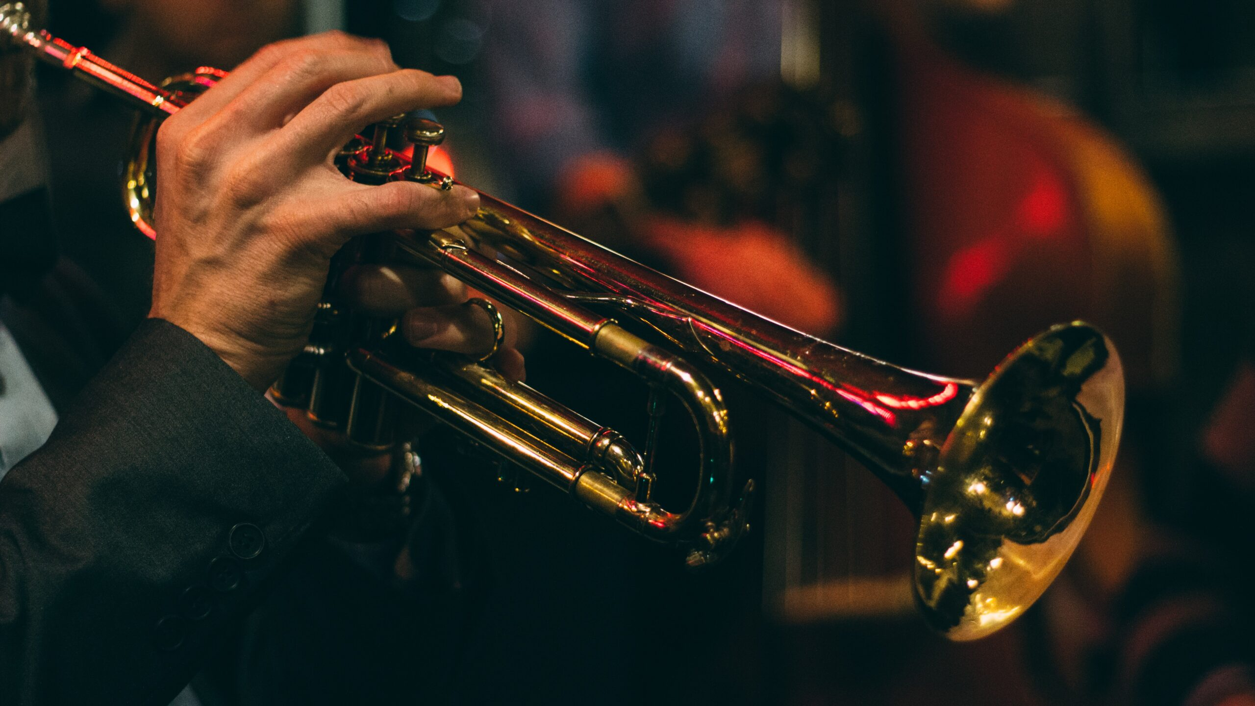 Trumpeter holding horn by Chris Bair from Unsplash