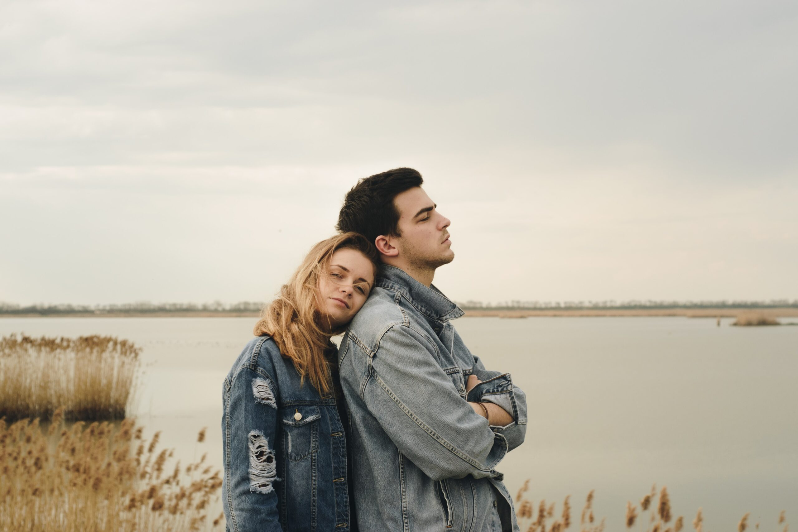 milan-popovic-Couple with male looking forward and female leaning against male's back-unsplash