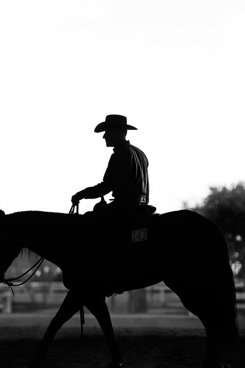 Photographer George Kamper's latest work inspires nostalgia of the Old West. Lyle on horseback in shadow