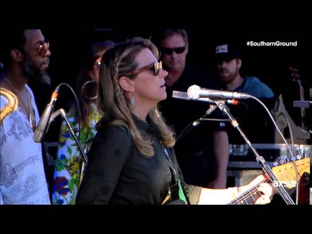 Susan Tedeschi foreground singing Midnight in Harlem with brass section in backdrop Charleston SC