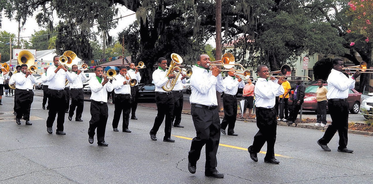 the United House of Prayer for All People Band marching in parade