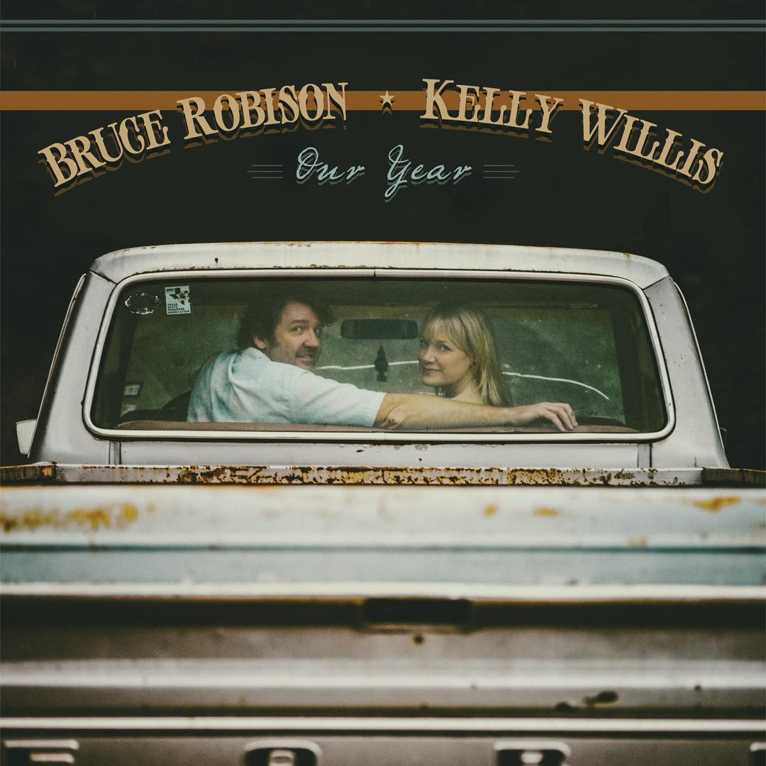 Kelly Willis and Bruce Robison looking out the rear window of flat bead truck