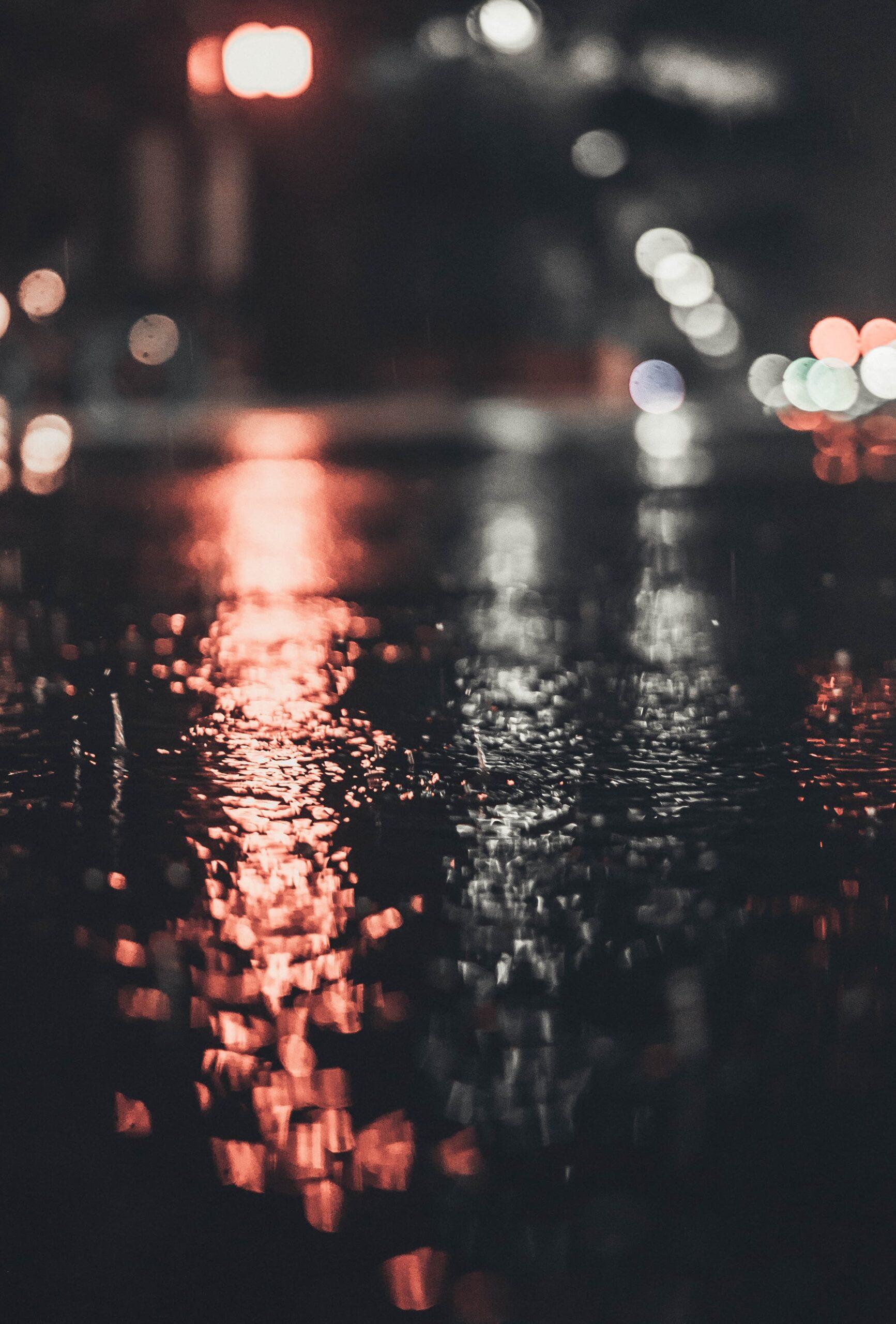 andy-grizzell-rain water splashing on street-unsplash