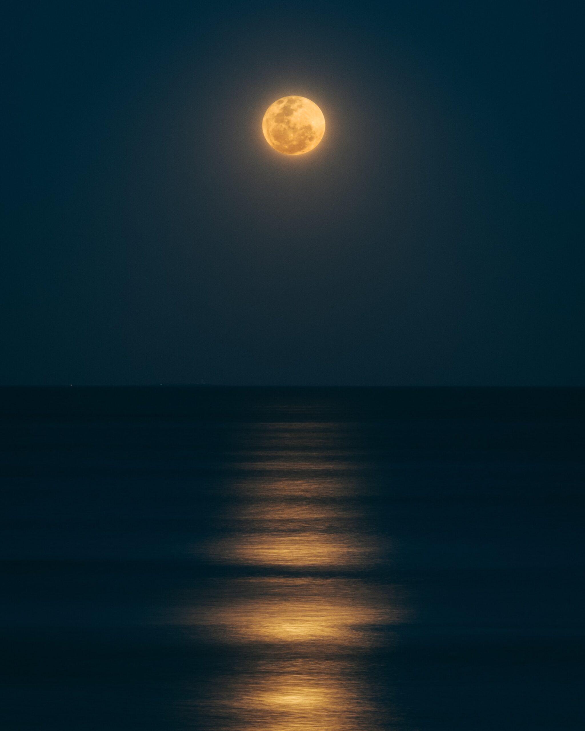 guzman-barquin-full moonlight over ocean-unsplash