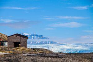vince-gx-Artic research building edge of glacier-unsplash