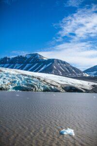 vince-gx-Artic tundra glacier meets water edge-unsplash