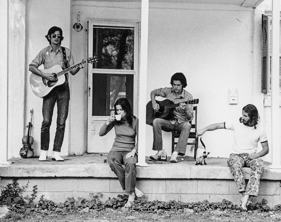 Townes Van Zandt, Susanna Clark, Guy Clark and Daniel Antopolsky on the porch at Guy and Susanna's house in East Nashville, 1972. Courtesy Guy Clark