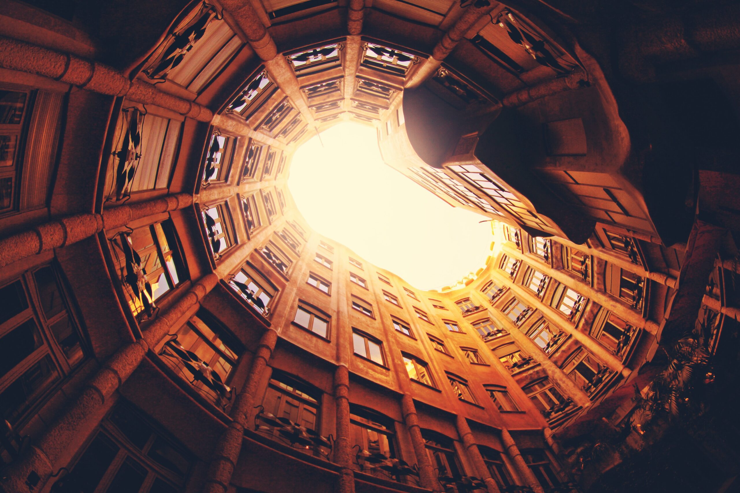 alexandre-perotto-Barcelona City image looking up to sky-sunlight-unsplash