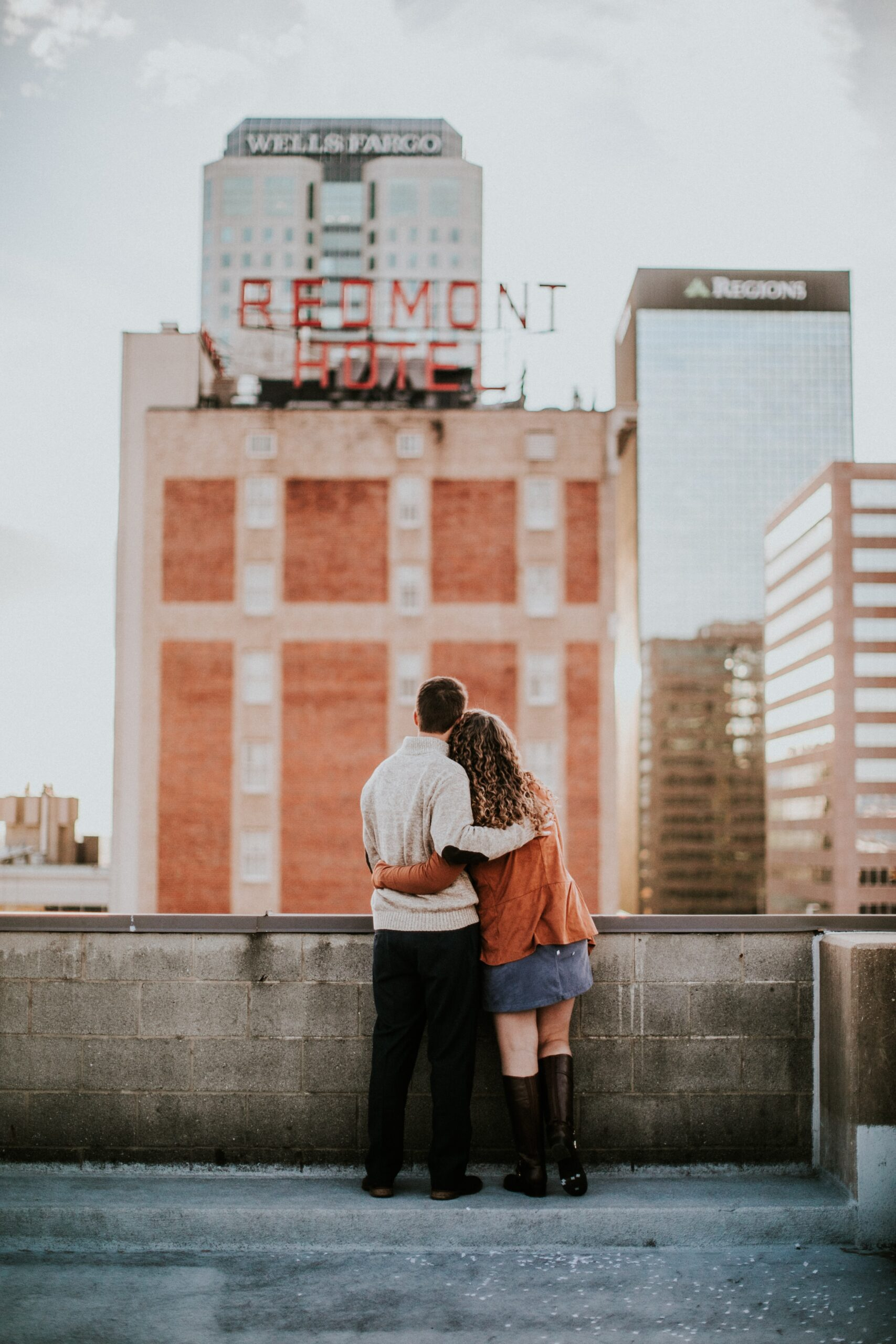 hannah-busing-Couple embracing on rooftop-unsplash