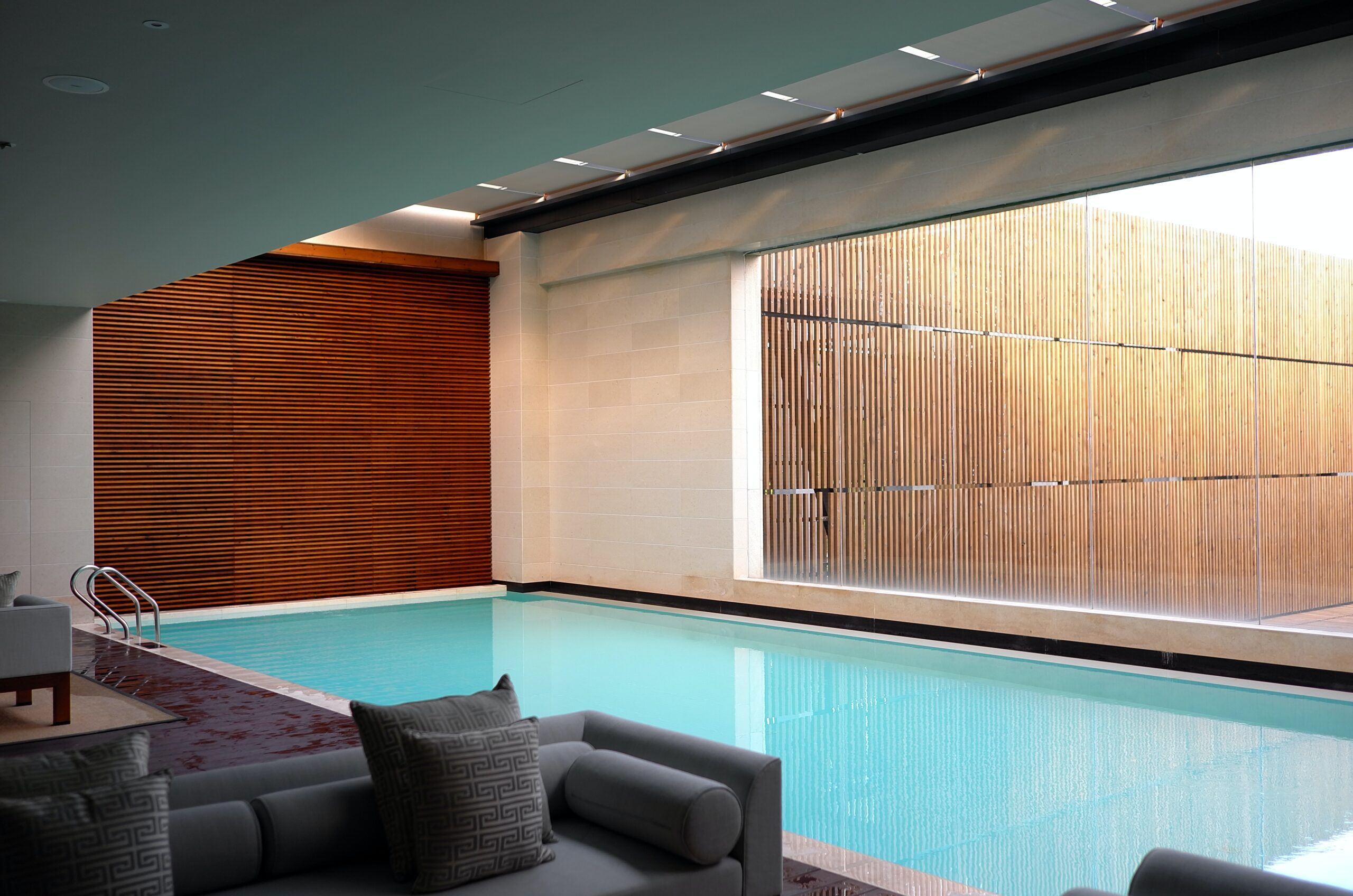 li-yang-Indoor pool contemporary home with bamboo blinds-unsplash
