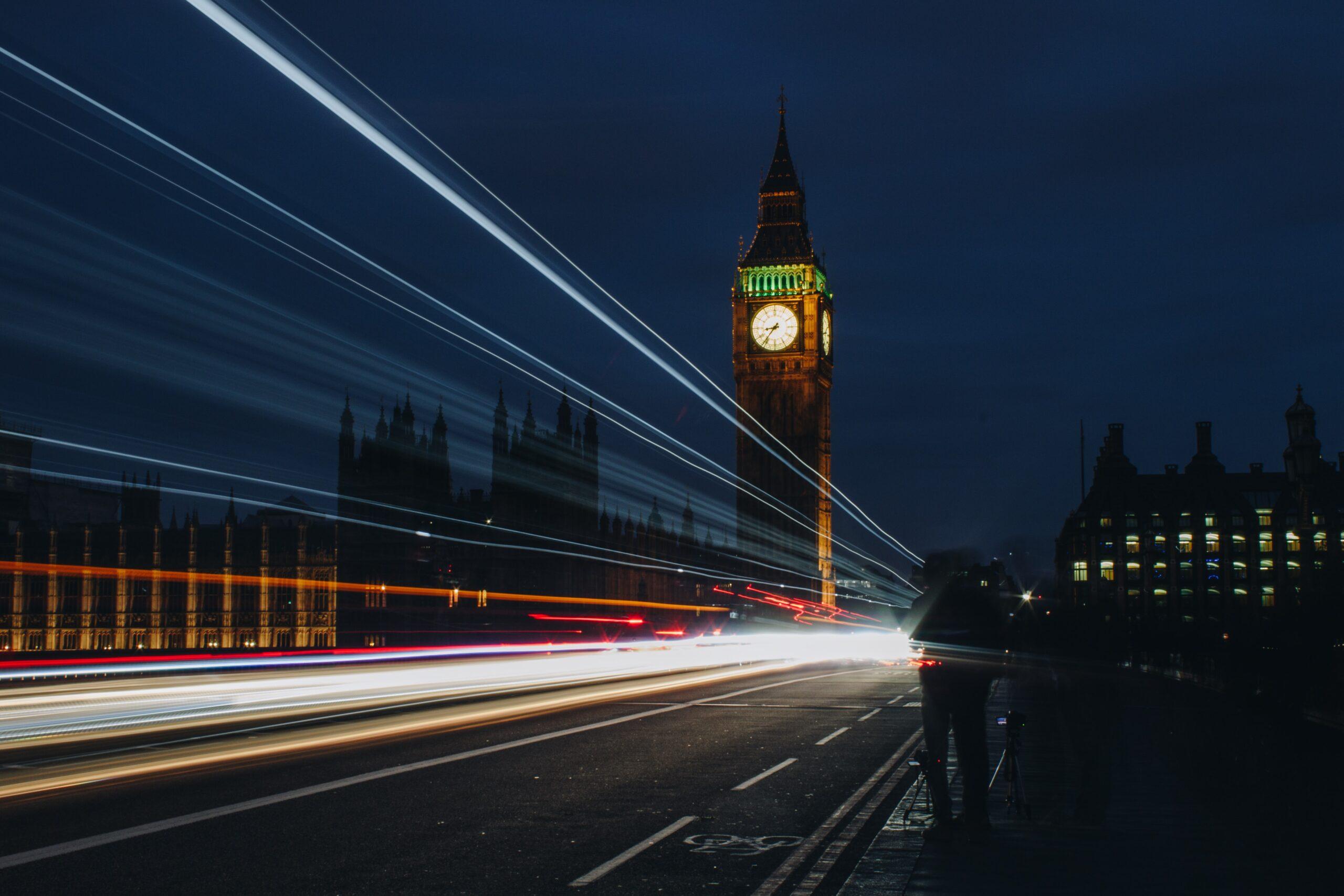 louis-k-London at night car lights over bridge sharp laser light-unsplash