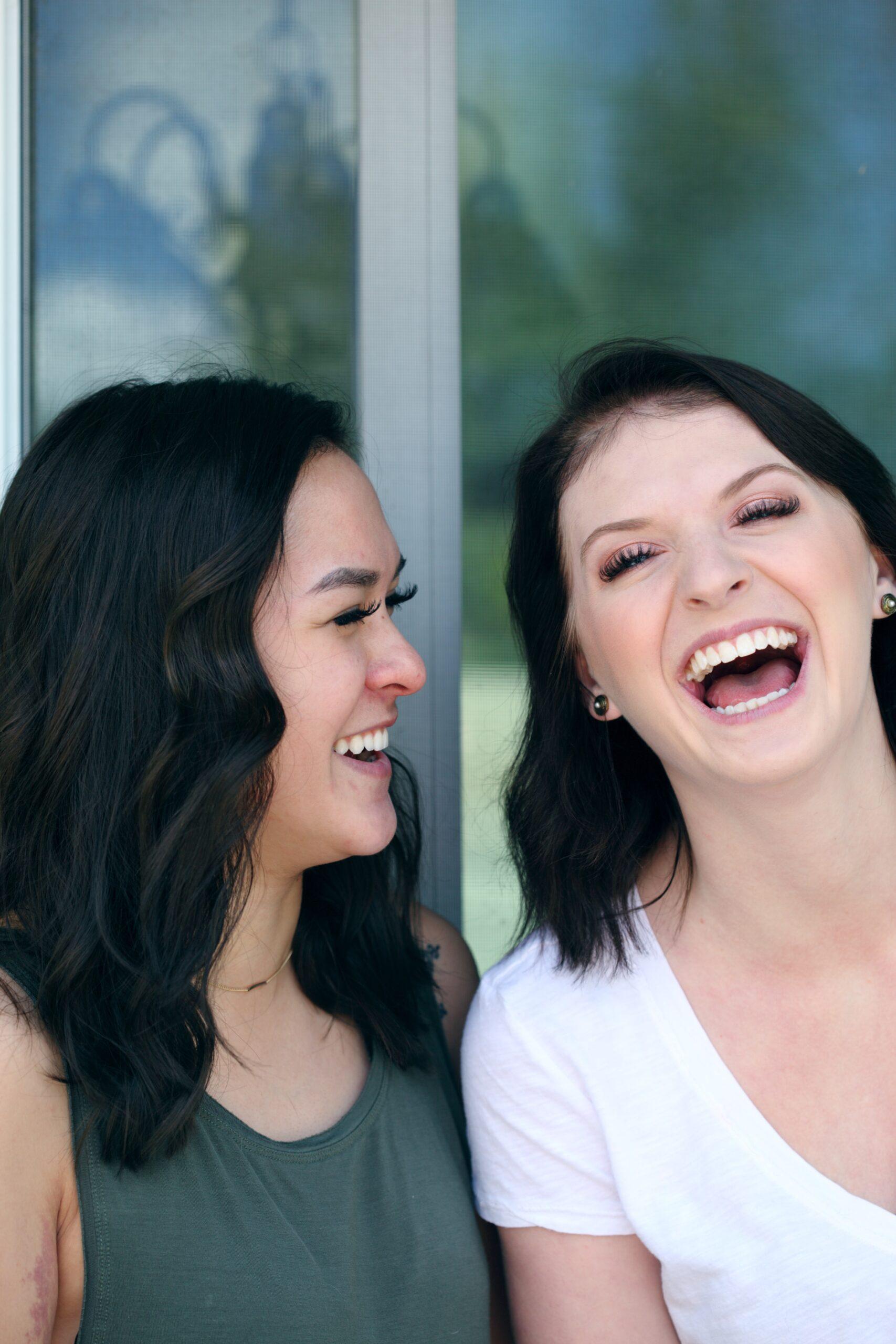 sharon-mccutcheon-female couple laughing together-unsplash
