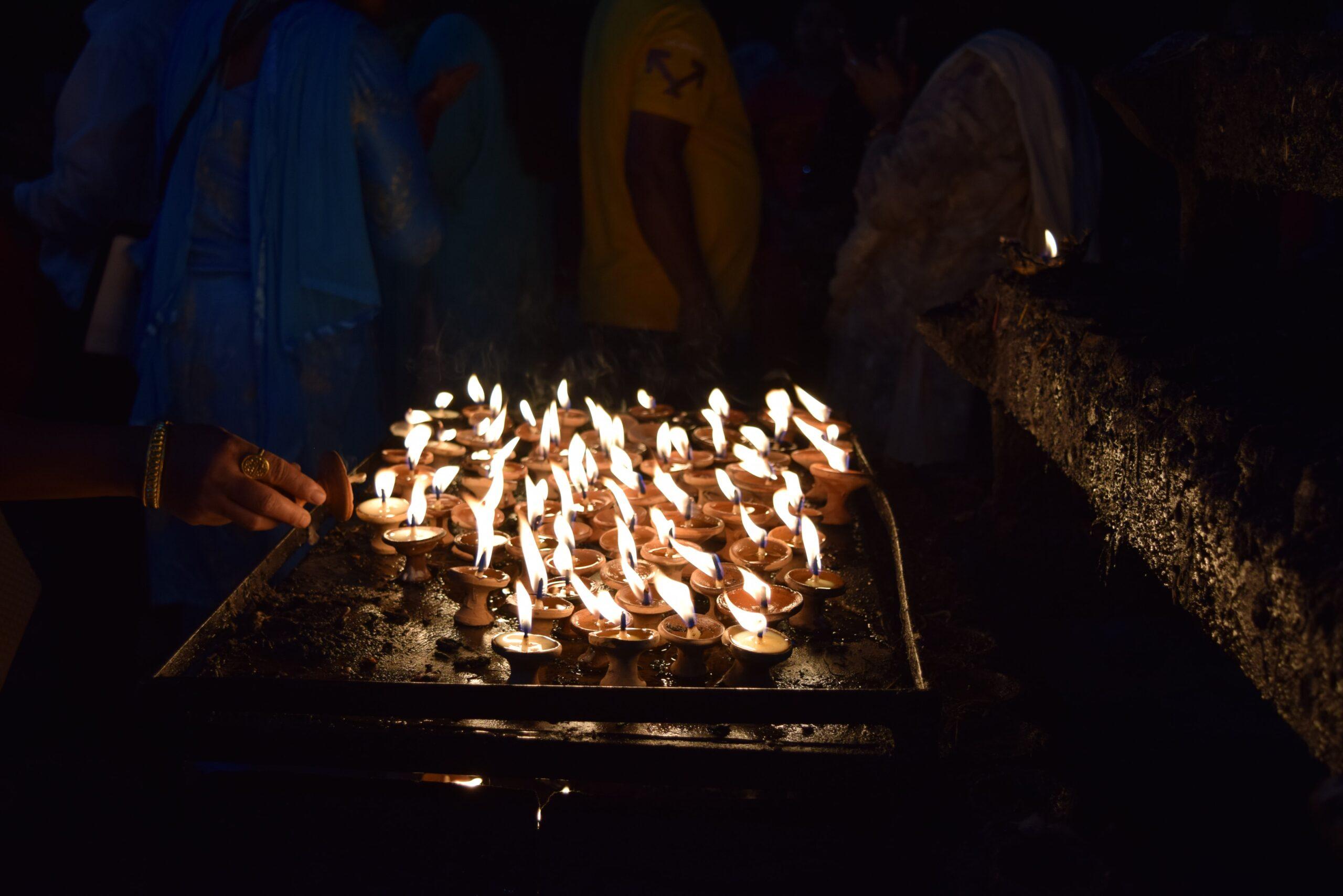 sumina-d-Votive candle lights at Hindu Temple-unsplash