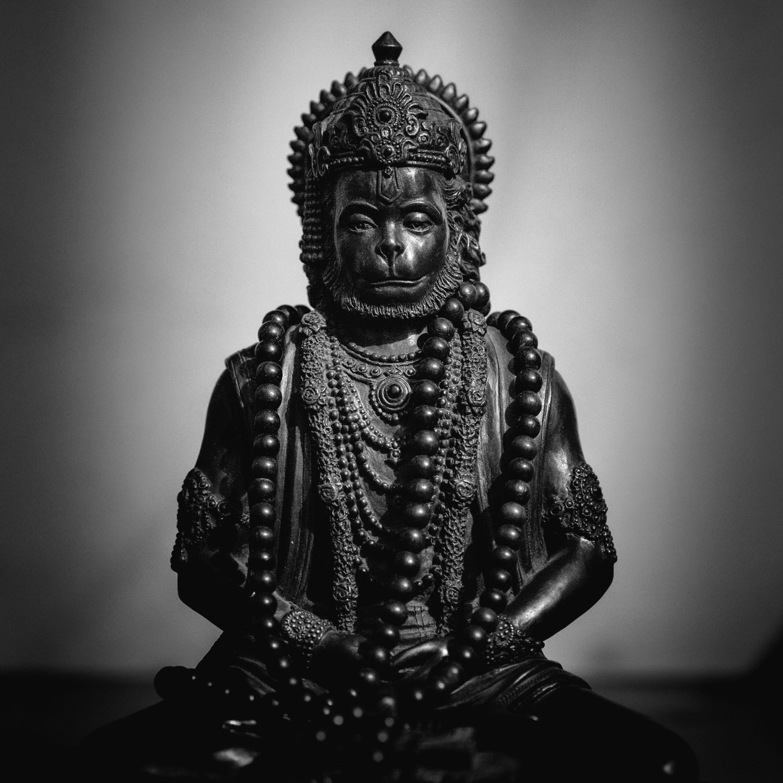 Hanuman bronze statue B&W image bt Tester Tyvg Unsplash