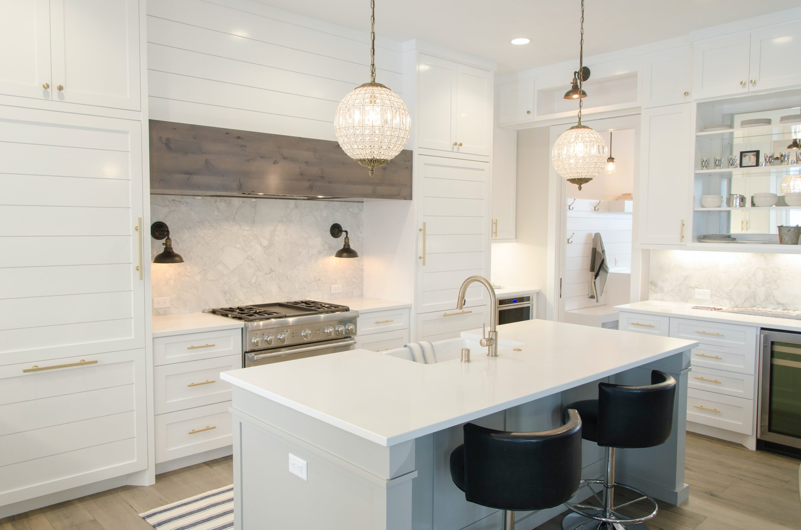 aaron-huber-galley stove center block kitchen with large hood-unsplash