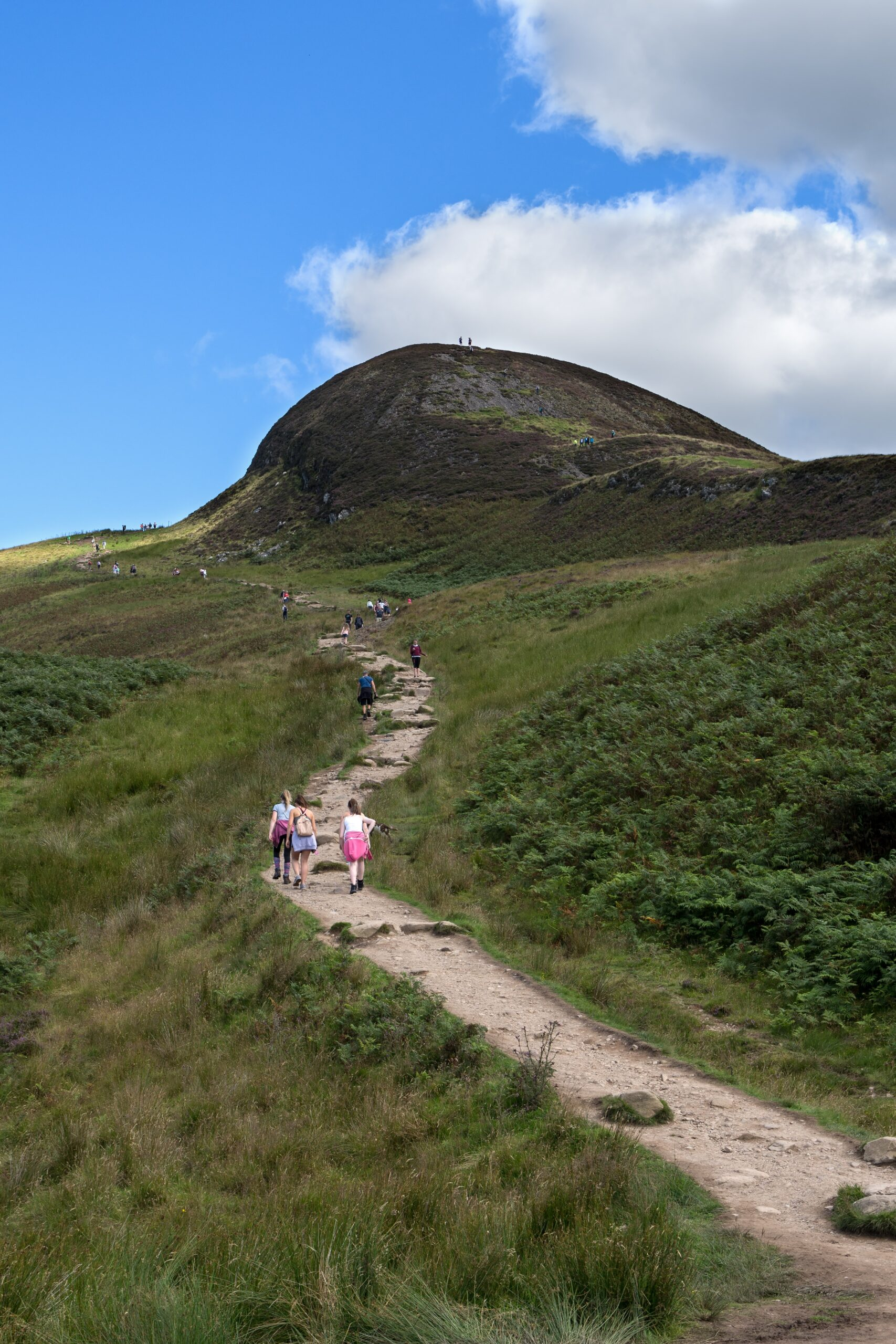 gary-ellis-Narrow hiking path up face of small mountain Scotlant awash with day hikers-unsplash