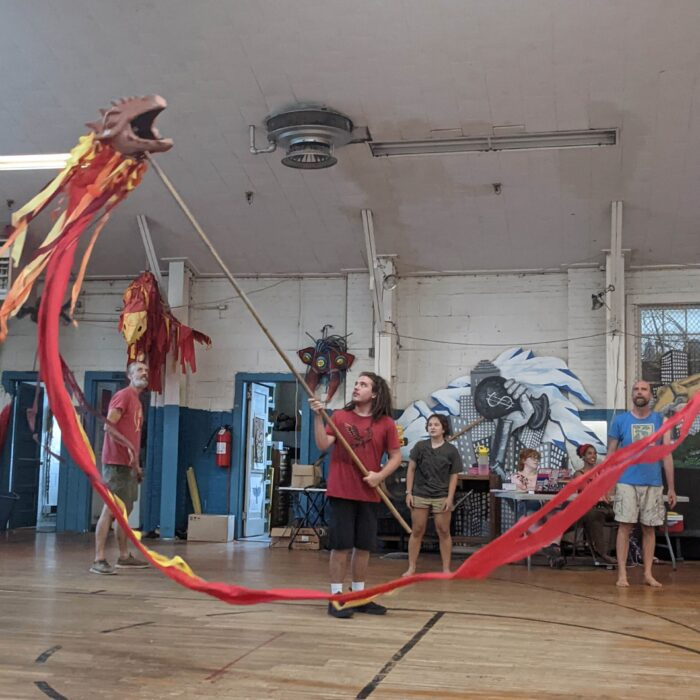 Sol Ramirez (puppeter) Animating Dragon puppet for Secondhand Theatre