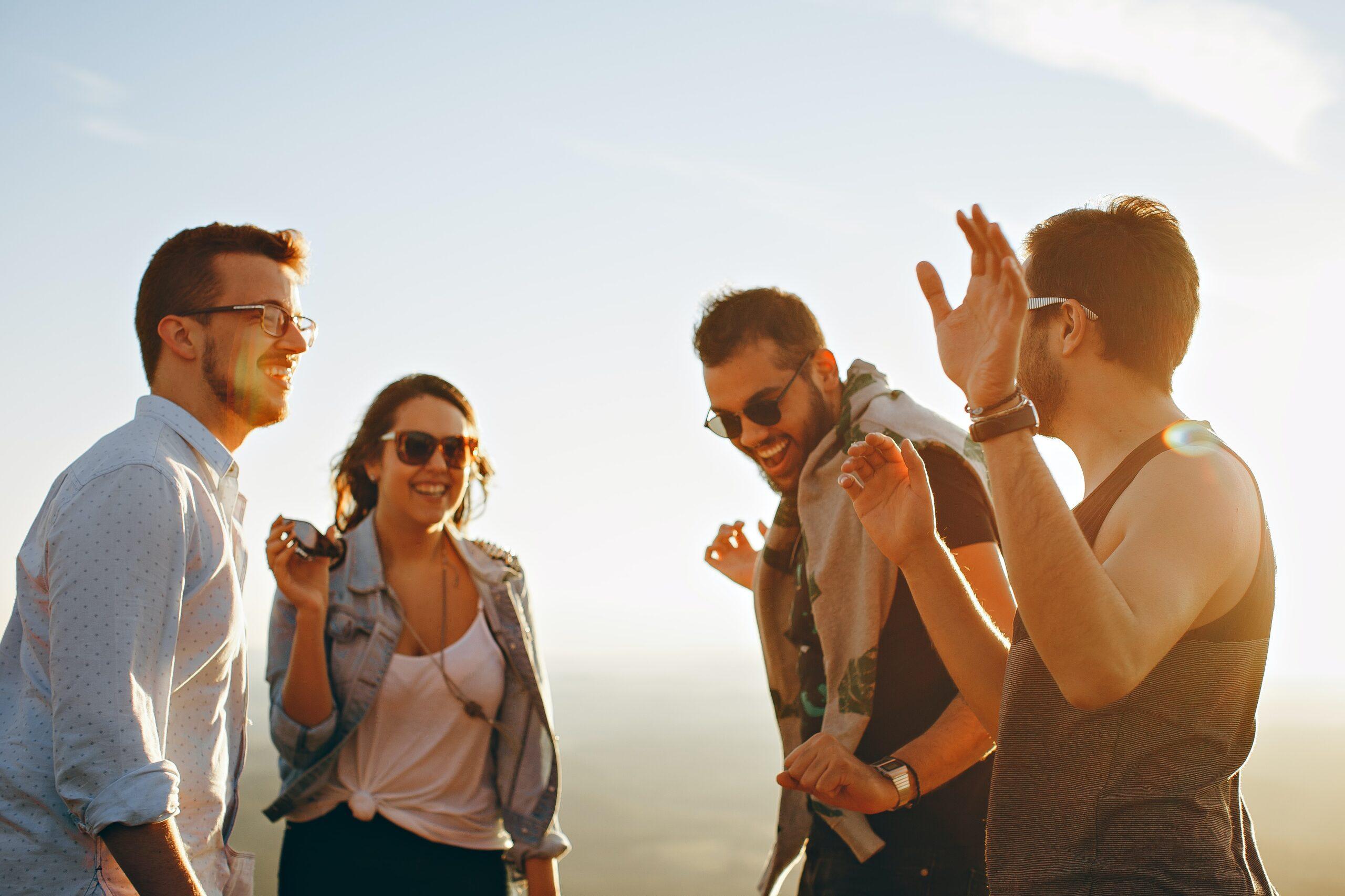helena-lopes-Group of friends talking outside-unsplash